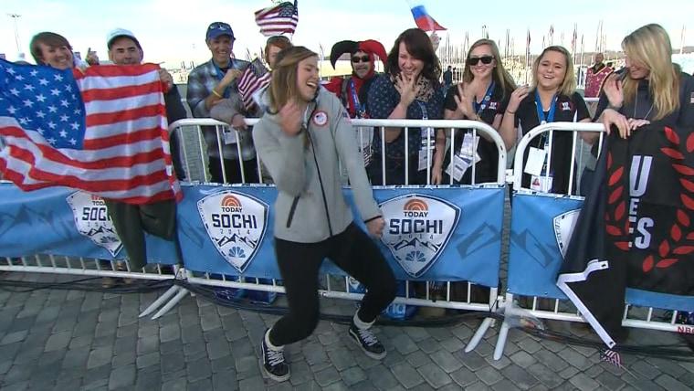 Kate Hansen dances on the Sochi plaza.