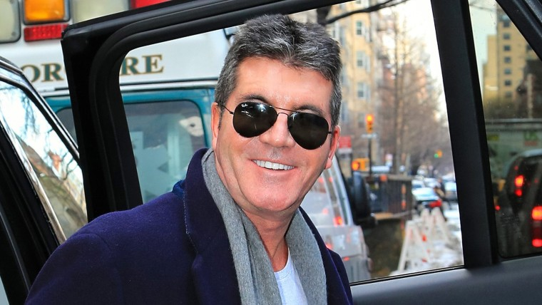 A very happy Simon Cowell is seen arriving at Lenox Hill Hospital on Friday in New York City to wait for the birth of his son.