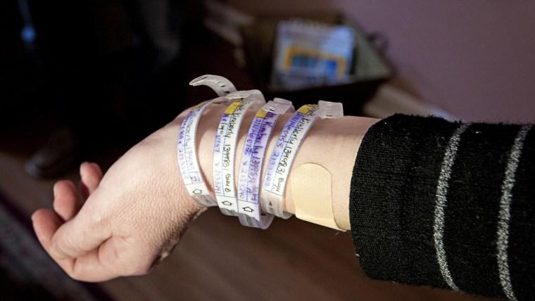 four hospital bracelets