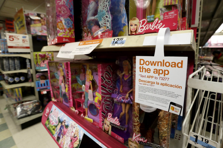 A sign for a shopping application is seen in the toys section in a New York Kmart. Last year, shoppers' satisfaction with online shopping dropped to a 12-year low.