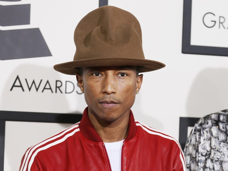 Musician Pharrell Williams and wife, Helen Lasichanh, arrive at the 56th annual Grammy Awards in Los Angeles, California January 26, 2014.     REUTERS...
