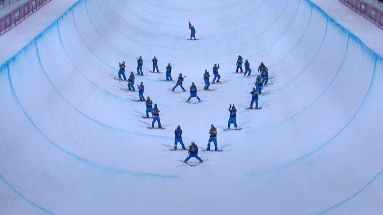 Skier Sarah Burke, who helped bring halfpipe sking to the Olympics, receives a heart-shaped tribute Thursday.