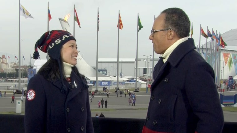 """Julie Chu complimented Lester Holt, who was also wearing the official Closing Ceremony outfit. """"You look great in it,"""" she told him."""