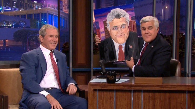 "More than two dozen paintings by former president George W. Bush will go on display in April at his presidential library. Here is he showing off one he made of Jay Leno in an appearance on ""The Tonight Show"" in November of last year."