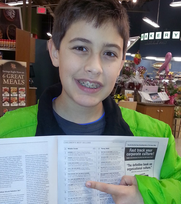 Jake points to his name and book on the New York times bestseller's list.