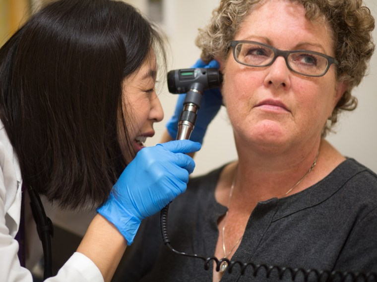 Physician assistant Mable Dunn examines patient Melanie Mitsui at Mary's Center, a community health center in Washington, D.C., on Thurs. Oct 17. (Joh...