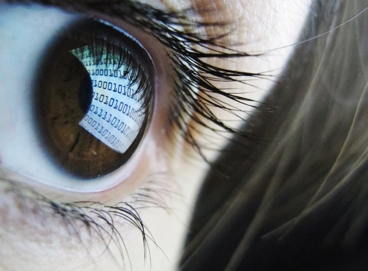 A computer screen reflected in a woman's eye.