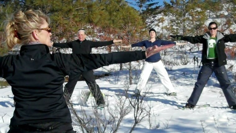 """Lynda Kennedy of Yogachelan demonstrates a """"sun"""" pose to a group of snowshoers in Chelan, Wash."""