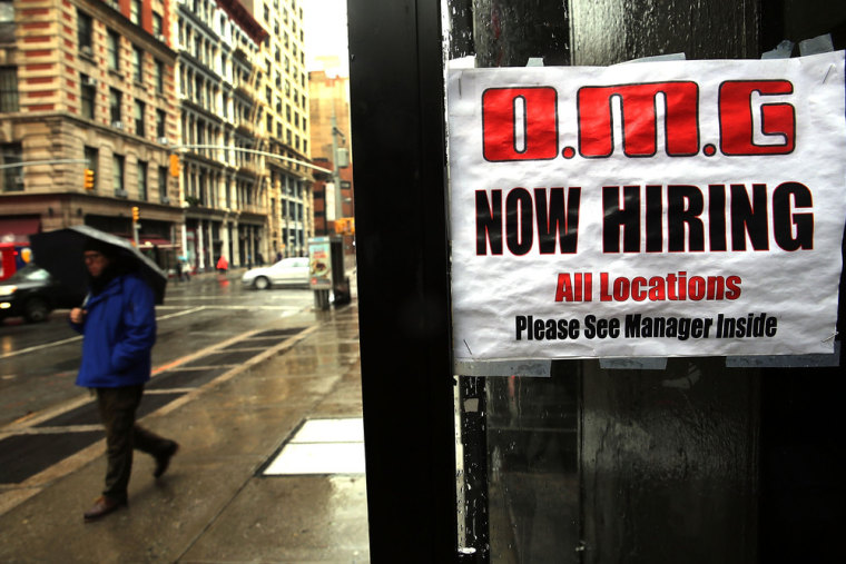 A sign in a window at a retail store advertises for a job opening on Dec. 6, 2013, in New York City.