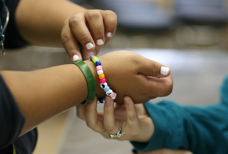 Seventeen year-old Marissa Hamilton gets help with her bracelet at Wellspring Academy in Reedley, Calif. Struggling with her weight Marissa enrolled at the Wellspring Academy in 2009, a special school that helps teens and college level students lose weight along with academic courses.
