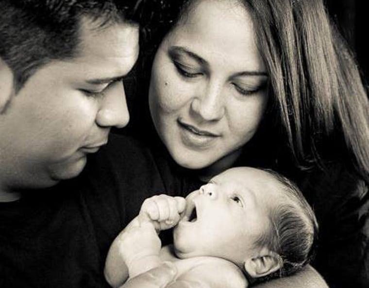Erick and Marlise Munoz hold their son Mateo.