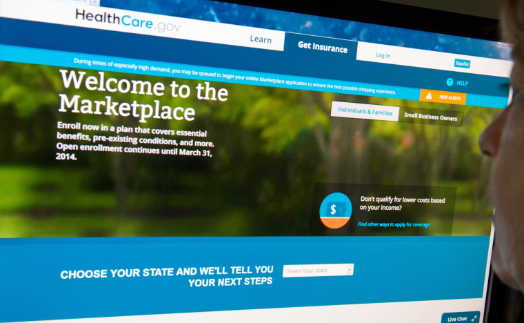 (FILES)This December 2, 2013 file photo shows a woman reading the HealthCare.gov insurance marketplace internet site in Washington, DC. President Bar...