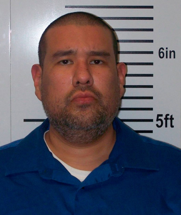 Anthony Joseph Garcia, 40, was being held in Illinois on suspicion of four counts of first-degree murder and four counts of using a weapon to commit a felony.