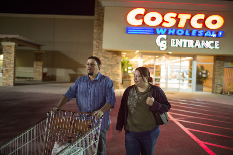 Ben and Erika Trowell exit a Costco in Phoenix, Ariz.