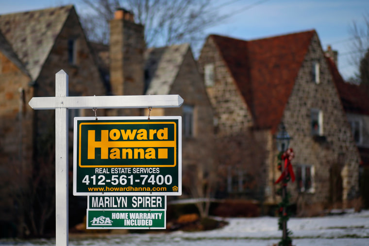 In this Thursday, Jan. 9, 2014, photo, a for sale sign hangs in front of a house in Mount Lebanon, Pa. The National Association of Realtors releases e...