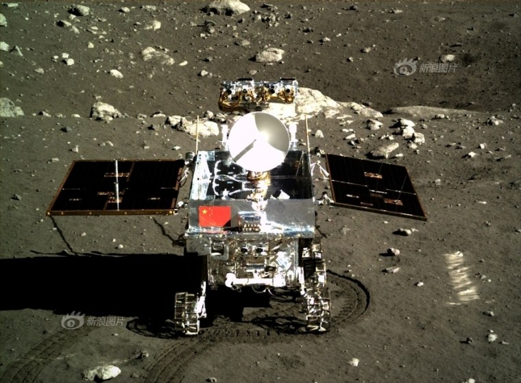 The Yutu moon rover displays the Chinese flag in a picture captured by the Chang'e 3 lander on Dec. 15.