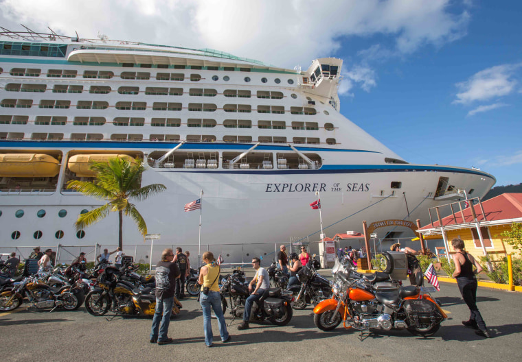 Passengers from a motorcycle cruises' tour group, prepare to board the Royal Caribbean International's Explorer of the Seas, docked at Charlotte Amali...