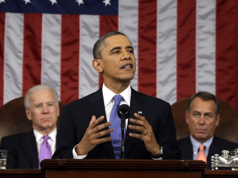 President Barack Obama, flanked by Vice President Joe Biden and House Speaker John Boehner of Ohio, gestures as he gives his State of the Union addres...