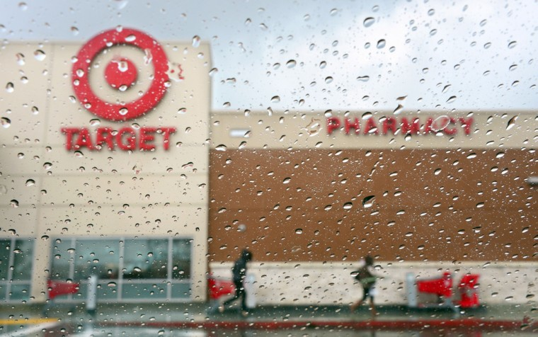 (FILES) A couple of shoppers leave a Target store on a rainy afternoon in Alhambra, California in this December19, 2013, file photo. Target said on Ja...