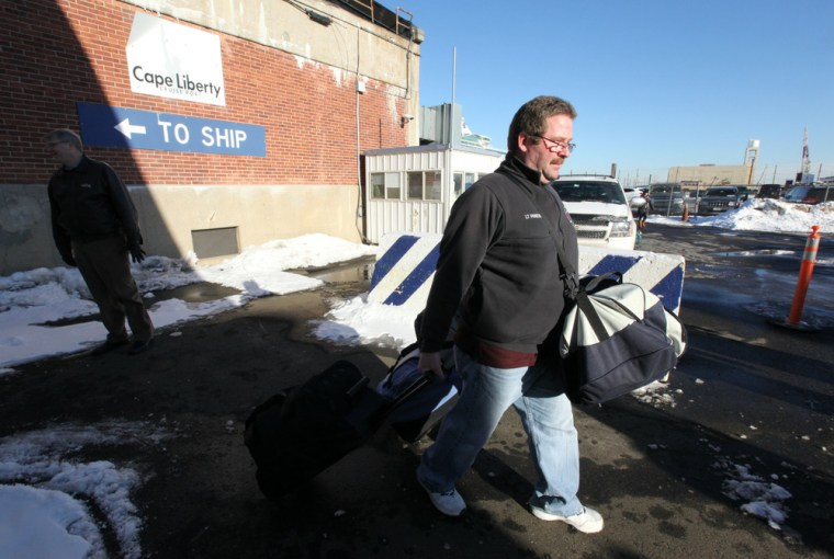 Wednesday, Jan. 29, 2014, in Bayonne, NJ (John Makely / NBC News) Dave Panebianco leaves the terminal with his wife Danielle. They both got sick, he ...