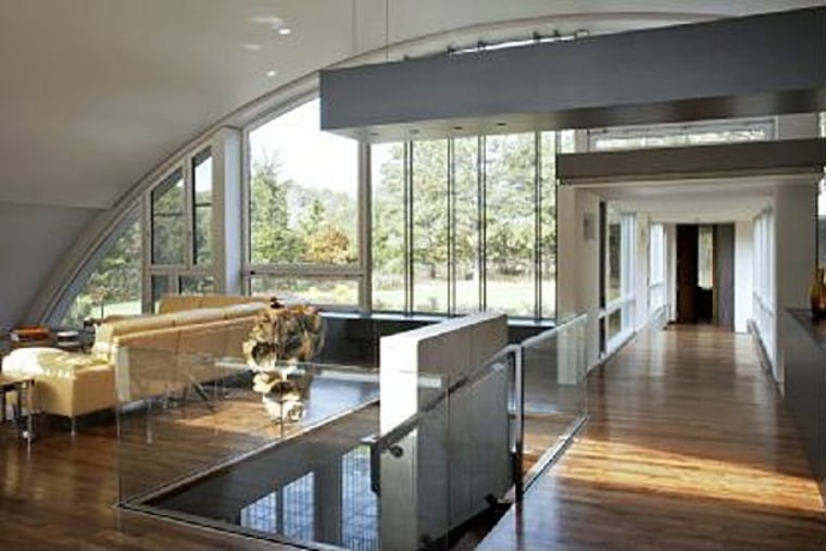 The three-bedroom, three-bath Arc House in East Hampton brings the outdoors in.