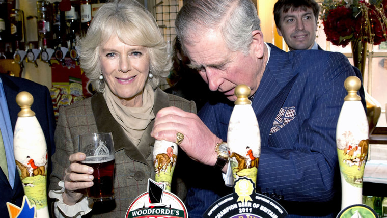 Prince Charles and Camilla, The Duchess of Cornwall, during a visit to The Bell Pub on Janyary 29, 2014.