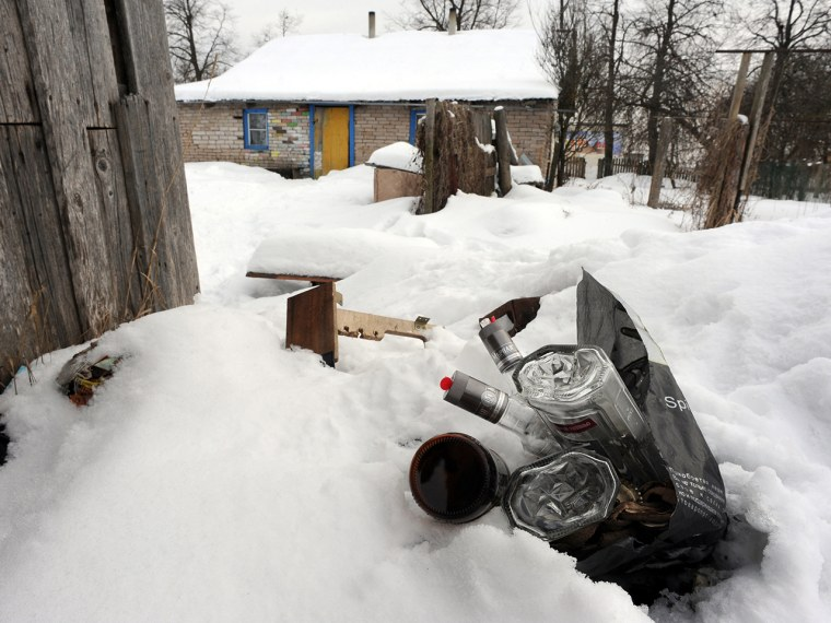 A picture taken in the Russian town of Gdov, 700 km northwest of Moscow, shows a bag with empty vodka bottles.