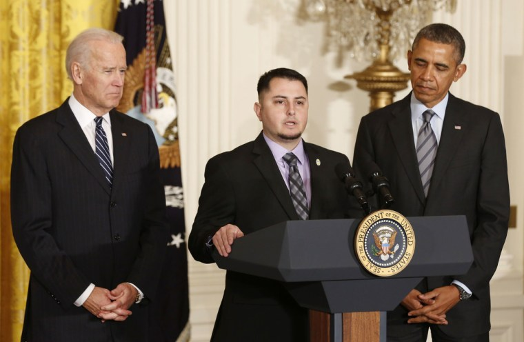 President Barack Obama (right) and Vice President Joseph Biden listen to apprentice electrician Erick Varela (center) of Pacific Gas and Electric discuss his previous unemployment, in the East Room of the White House on Jan. 31. A veteran, Varela couldn't find work when he returned from Iraq in 2008 and ended up homeless for a time.