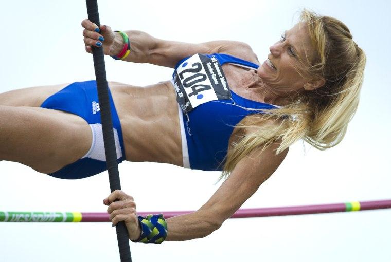 Image: Kay Glynn pole vaults during the 2011 National Senior Games
