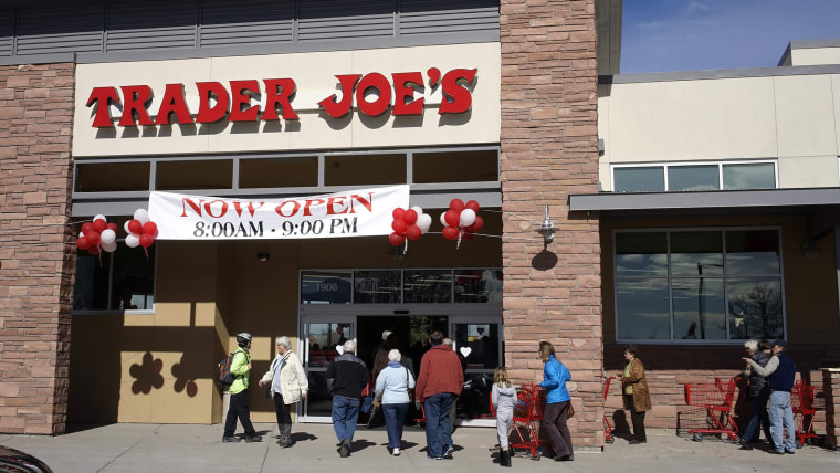Shoppers line up to enter the new Trader Joe's store in Boulder, Colorado in this file photo taken February 14, 2014.  U.S. retail sales rebounded in ...