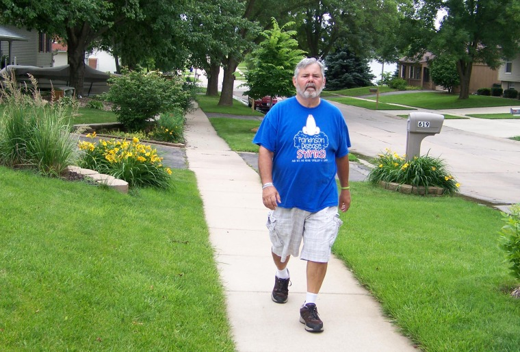 Parkinson's patient and activist John Krumbholz of Cedar Rapids, Iowa takes a walk. A new study shows walking can reduce the symptoms of Parkinson's d...