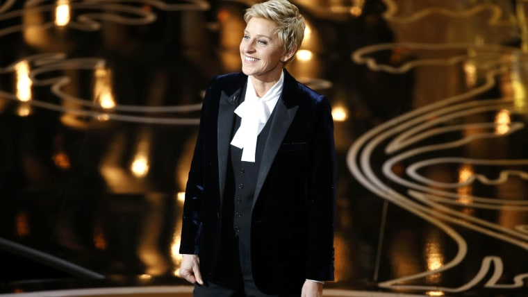 Ellen DeGeneres takes the stage to host the show at the start of the 86th Academy Awards in Hollywood, California March 2, 2014.    REUTERS/Lucy Nicho...