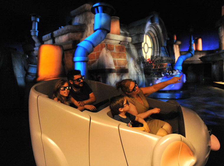 "Ratatouille: L'Aventure Totalement Toquée de Rémy is a dark, trackless ride that will take visitors across the rooftops of the city and through the restaurant's kitchen and dining room in four-person ""ratmobiles."""