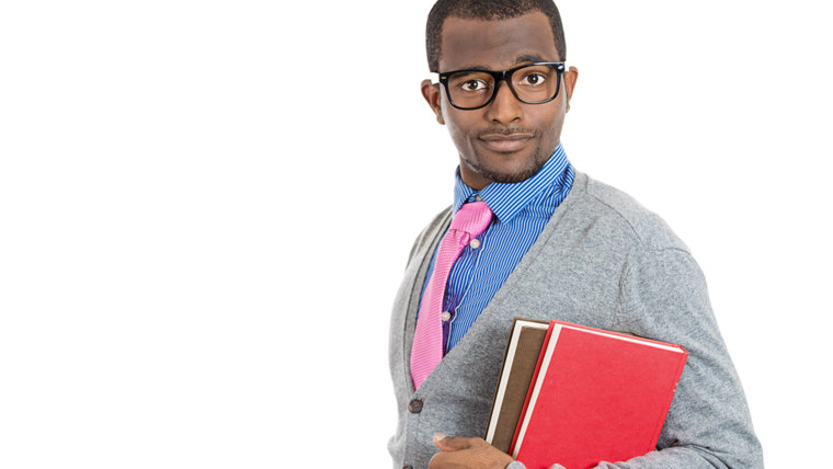 Closeup of a young smart handsome man, wearing big glasses, holding books, prepared and ready to ace his exam test finals, isolated on white backgroun...