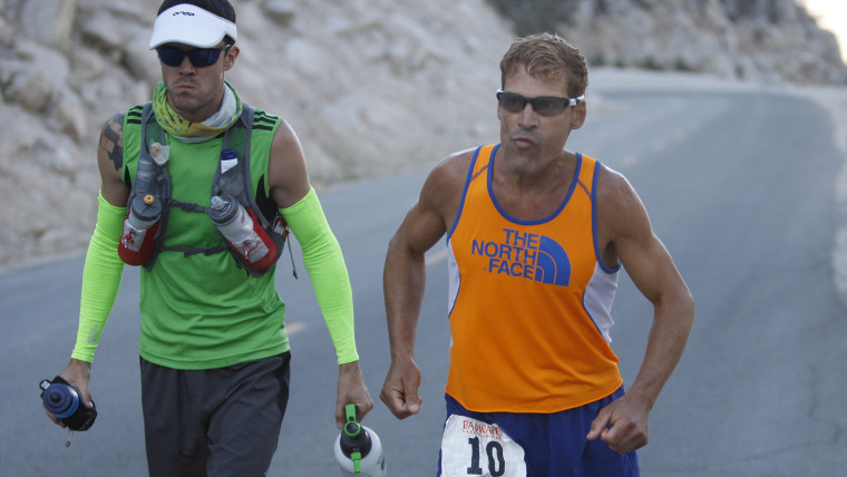 DEATH VALLEY NATIONAL PARK, CA JULY 16:  Dean Karnazes of Ross, California runs stiff with pain as he ascends the last few miles of Whitney Portal Roa...