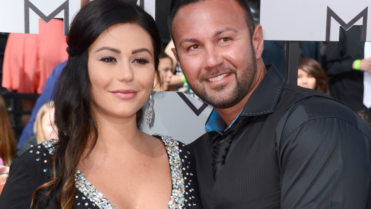 """Jennifer """"JWoww"""" Farley, left, and Roger Mathews arrive at the MTV Movie Awards on Sunday, April 13, 2014, at Nokia Theatre in Los Angeles. (Photo by ..."""