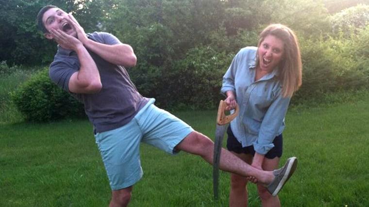 Joe Pleban and his girlfriend, Johnna Hetrick, 27, pretend to saw off Joe's foot.