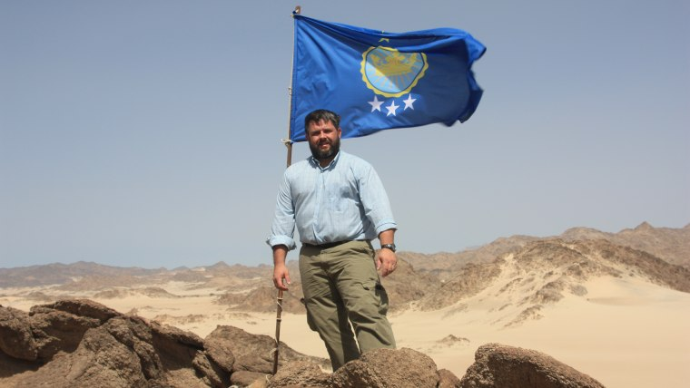 Jeremiah Heaton with the flag he designed for Egyptian land he claimed so that his daughter could be a princess.