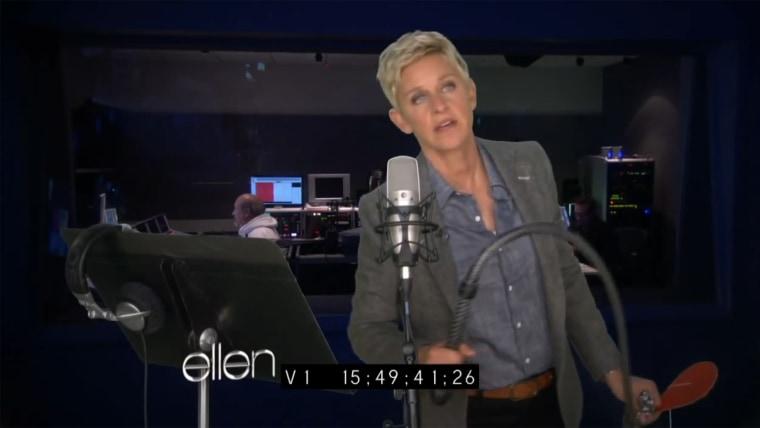 "IMAGE: Ellen DeGeneres reads ""Fifty Shades of Grey"""