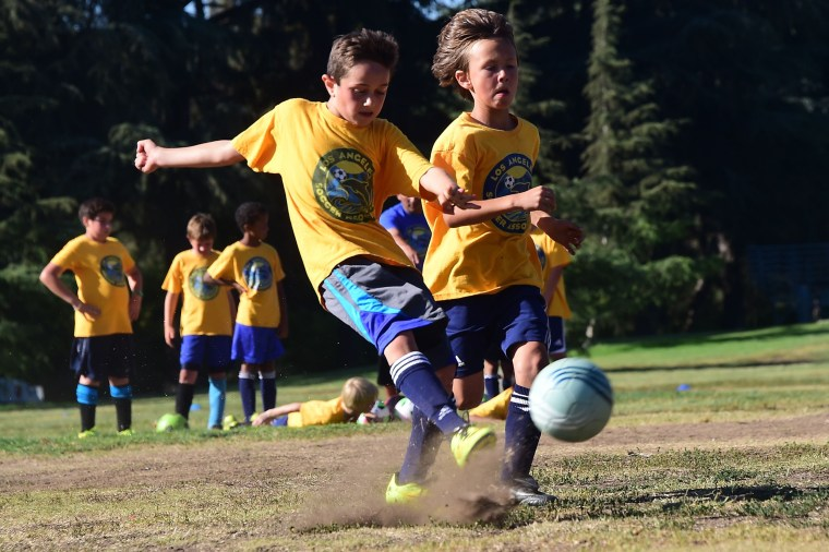 Youth soccer players from coach Jose Aguilar's team of under-10-years-olds work on their shooting during a training session for players in the Los Angeles Soccer Association on June 4, 2014, in Los Angeles.