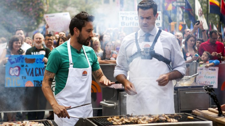 Andrew Gruel and Carson Daly cook surf 'n' turf on the TODAY show in New York, on July 31, 2014.
