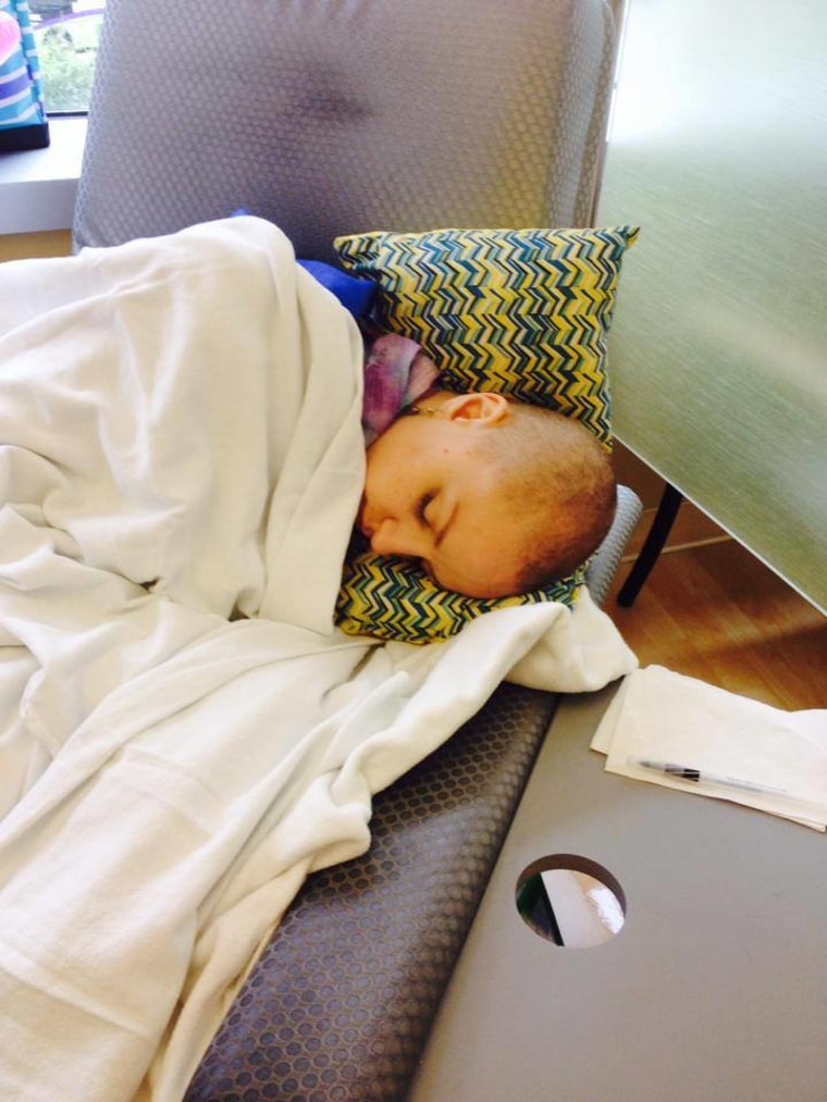 Maggie takes a nap during one of her chemo treatments.
