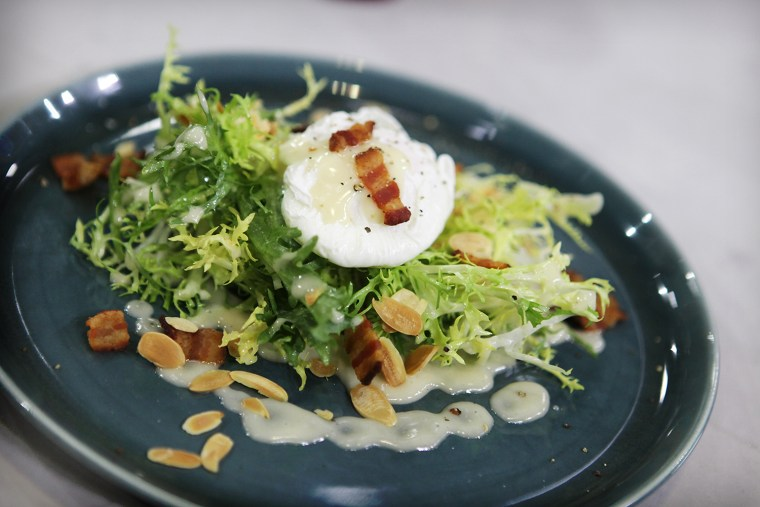 Poached eggs, frisee salad with bacon lardon, toasted almonds and Dijon vinaigrette