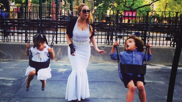 Mariah Carey with her kids at a park.