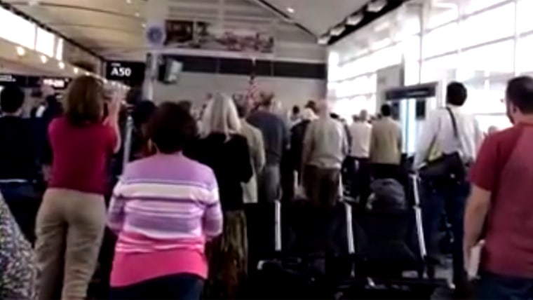 A Delta gate agent sang the national anthem to WWII veterans at DTW airport.