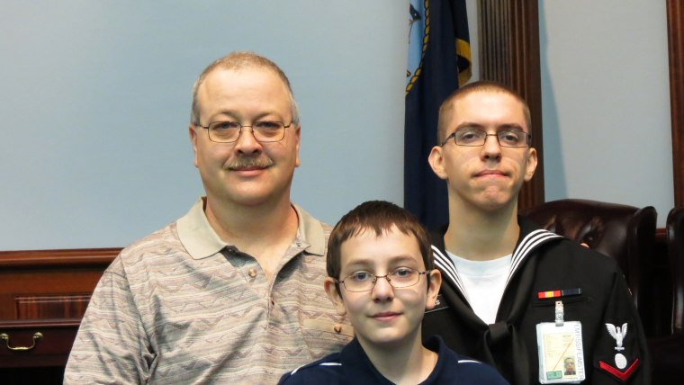 Jeff Jones stands with sons Dylan and Nicholas in March of 2013. Jeff was a stay-at-home dad for most of Dylan's childhood and is still home full time...