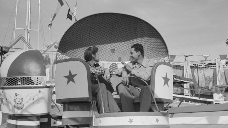 Image: A couple in a fair ride in 1942.