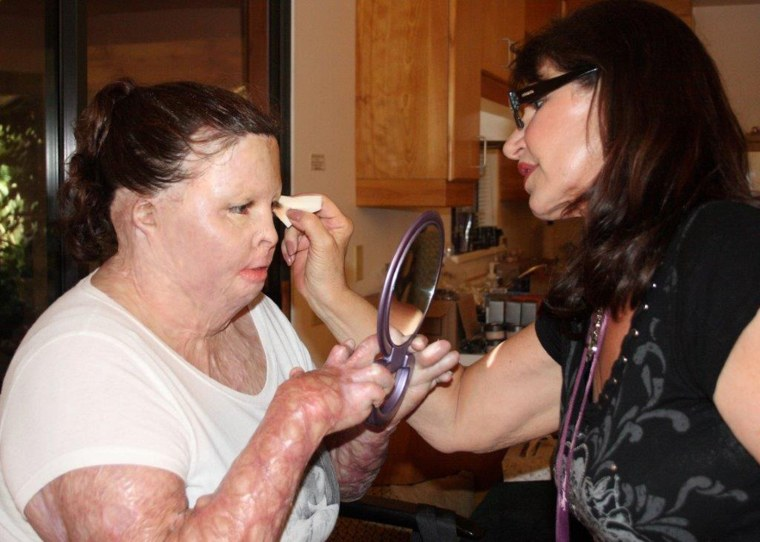 Nancy Ogden West, a corrective cosmetics professional, shows participant Stazia Porter how to apply makeup.