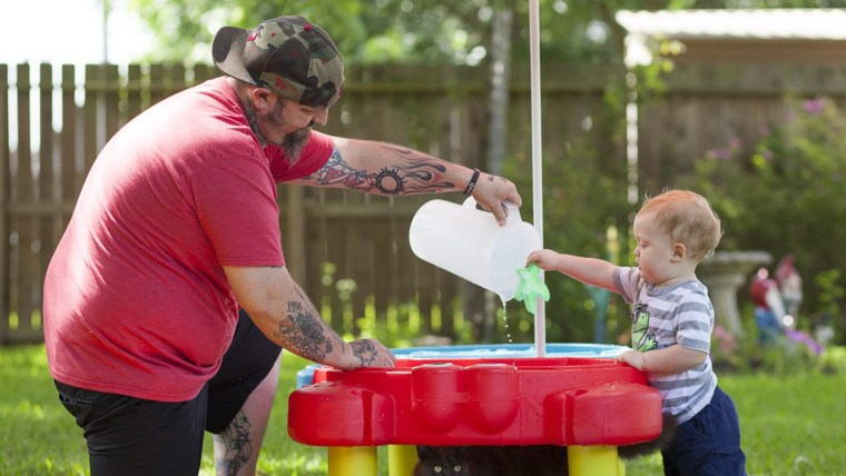 Image: Lance Stewart plays with his son Connor, 1, at their League City, Texas, home.