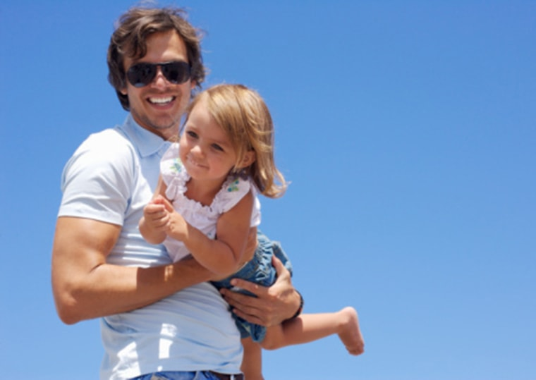 Father and daughter (2-3) having fun, pictured against clear sky Casual Clothing, Excitement, Happiness, Enjoyment, Bonding, Togetherness, Horizontal,...
